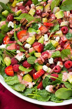 Strawberry Raspberry Cranberry Avocado Spinach Salad with Strawberry Poppy Seed Dressing - this is the ULTIMATE summer salad! Its totally irresistible!