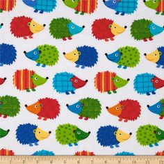 From Timeless Treasures, this cotton print fabric is perfect for quilting, apparel, crafts, and home decor items. Colors include white, turquoise, green, red, orange, and yellow.