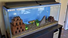 Epic Terrarium Tank on this article from Lifehacks on creative uses for legos
