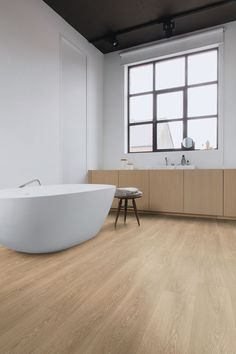 A modern bathroom doesn't always need much to impress: a great laminate flooring idea, like this one can do the trick. The oak planks look stunning and are extremely DIY friendly. 📸 Quick-Step Majestic 'Valley oak light brown' (MJ3555) #laminate #flooring #inspiration #oak #bathroom #interiordesign