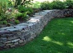 pennsylvania bluestone drystack wall.  This would be nice for your courtyard walls (capped with coping).: