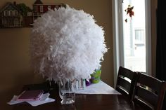 excersise ball hot glue feathers Voila!