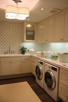Laundry - white cabinets & wallpaper - I'd love to do this, but as my laundry is in the garage...