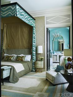 In the master bedroom, the bed is by Jean-Louis Deniot for Collection Pierre, and the canopy is of a silk by Brunschwig & Fils, lined with a fabric by Colefax and Fowler; the carpet by Diurne and the nightstand are custom designs.  This article originally appeared in the November 2015 issue of ELLE Decor. Learn more about the home here.   - ELLEDecor.com