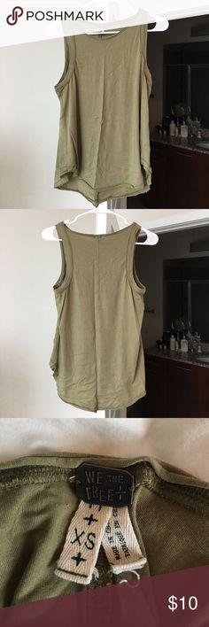 Free People Olive Tank Loose silhouette, great condition, and fits XS and S. Casual tank and lightweight material. Free People Tops