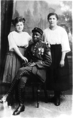 "Colonial soldier with German women, 1919. In the period following World War I, French colonial troops were used as part of the Allied occupation of the German Rhineland, in accordance with the Treaty of Versailles. Germ Hitler wrote about the Black Shame in Mein Kampf, decrying the ""negrification"" of Europe.  His government would later sterilize 500 or so mixed-race children born of African servicemen and German women (the so-called Rhineland Bastards""),"