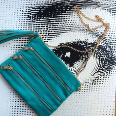 Turquoise Multi-Zip Medium Crossbody Bag Brand new, never used bag by melie bianco from boutique in Brooklyn. W: 10 in, H: 7.5 in, D: approx 1-2 in, shoulder strap length (gold chain): approx 48 in total. Loved the style but never has the chance to wear before getting a similar bag I like more. Soft faux leather in a gorgeous turquoise color with gold zipper, should strap chain. 3 outer zipper pockets, zip top closure with cute turquoise/gold accented tassel. Inside features polka dot lining…