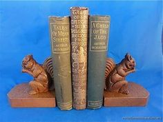 ARTS AND CRAFTS CARVED OAK SQUIRREL BOOKENDS