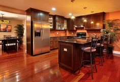 Awesome kitchen. I love the island, fridge, and cabinets! Great colors, too.