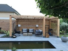 The perfect seating area for the garden. Garden furniture in modern wooden pergola. The perfect seating area for the garden. Garden furniture in black with matching casual hanging chair. The post Modern pergola made of wood. Pergola Diy, Wooden Pergola, Pergola Plans, Pergola Carport, Carport Garage, Corner Pergola, Backyard Pergola, Pergola Screens, Black Pergola