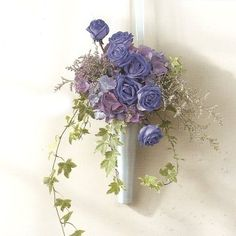 Good idea for pew for wedding with purple and yellow roses or carnations.