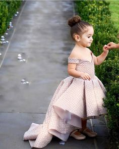 Just the cutest flower girl ever! With the off-shoulder dress and ballerina  bun a3631bd254f0