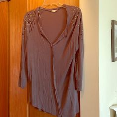 Super soft 3/4 sleeve gray shirt This shirt is so soft! Pretty rhinestone detail at the shoulders. Sleeves are 3/4 length Tops Blouses