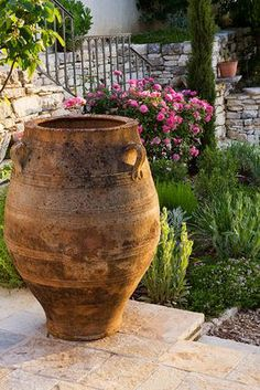 An old stone urn stands in a garden in Corfu ~