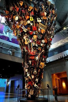An impressive sculpture art comprised of many guitars in different sizes, shapes and colours. The sculpture is actually in the shape of a horn. Original and unique appearance.