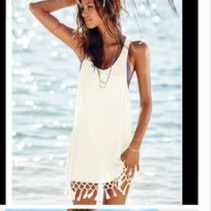 "White Cotton Fringed Beach Cover Up Slip on this fabulous Victorias Secret cover up and you're ready for your next pool party or tropical getaway This cover up has a relaxed oversized fit and is semi sheer. Scoopneck. Racerback. Low armholes. Machine wash. Imported cotton. Comes in original sealed Victorias Secret package. Available SMALL (4/6) fits bust 34.5-35.5, waist 26""-27"", hips 36.5""-37.5"". Measures 35"" from top of shoulder to bottom of fringe. Victoria's Secret Swim Coverups"