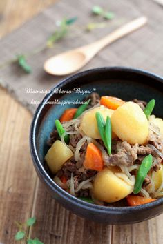 Beef, onion, carrot, potato konjac (type of root) noodles cooked in a pan with 2 cups of soup stock, sake, mirin, soy sauce, sugar.