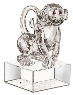 """Swarovski Zodiac Monkey   $300.00 3 7/16""""   Item# 1080230          In the Chinese Zodiac, the Monkey is considered to be innovative and charming. This exquisite design sparkles in Crystal Silver Shade with Smoked Topaz crystal eyes and Moroda crystal pupils. The clear crystal base is engraved with the name of the Zodiac in English and Traditional Chinese seal script. The perfect gift for people born in the Year of the Monkey!"""