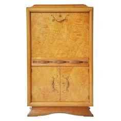 Art Nouveau Fall Front Cabinet in the manner of Jules Leleu (Fall Front Desk or Bar) - French burl amboyna fall front cabinet, in the manner of Jules Leleu. Perfect for a fall front desk or dry bar.  Diamond pattern front panels creates a three dimensional background. The top hinged panel reveals a mirrored back and work surface, four smaller drawers and one larger drawer separate the shelves creating cubby holes.