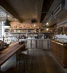 pizza east  This restaurant in London evokes a feel of industrial meetscountrykitchen, through the use of reclaimed wood, old school chairs, reclaimed antique lamps, exposed ducting, surface mounted fittings, white crackled tiles with bands of green stripes and soft lighting throughlargeloft style windows. I wonder what the food is like?