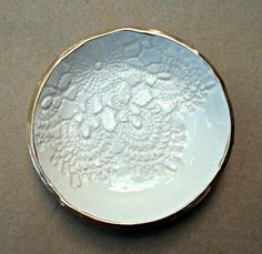 3 3/4 inches round Off white Cream lace ring holder bowl signed on unglazed bottom  The color is antique white This piece was fired, hand glazed, then