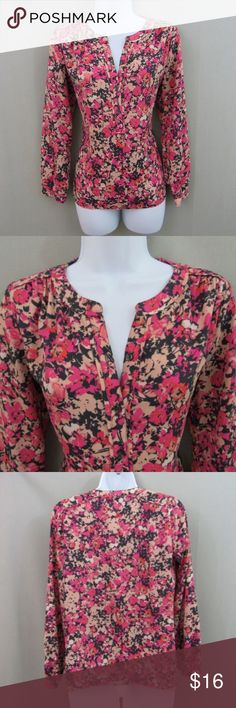 Loft Floral Long-Sleeve Blouse Spring must have! This sexy yet classy Loft floral blouse is essential for your spring closet line up. Black background overlayed with soft and hot pink flowers. Blouse buttons down 1/3 of blouse (see photos). Size small.  100% polyester for easy washing and care. Perfect for day off or day at the office. LOFT Tops Blouses