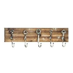 Hang this delightful key hook rack in your entryway, and never lose your keys again. This distressed wood rack features rustic chipped paint as well as key-themed hooks for a touch of whimsy.