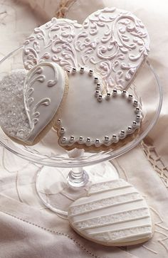 Great for a wedding. White design heart shaped cookies I know a great baker who could make these!! :)