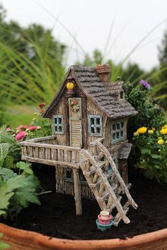 This house is solar! The lantern lights up above the door. #miniaturefairygardens