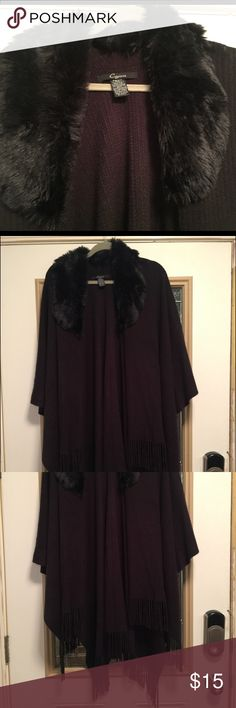Black shawl with fur collar and fringe Perfect over a formal gown or jeans.  Long black shawl with fringe at the bottom and fur around the collar.  Always received compliments.  Worn a handful of times and it needs a new home. :). One size but plus size.  100% acrylic with faux fur. cejon Tops