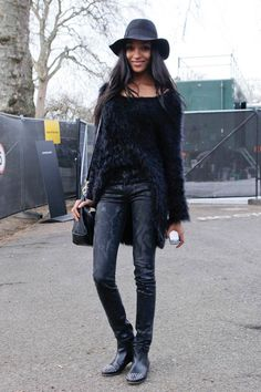 All back outfit consisting of a furry sweater, printed pants and boots with gold studs.