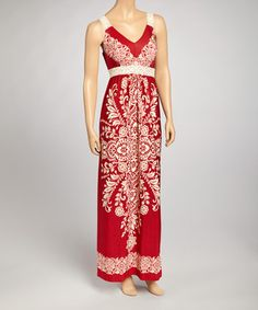 This ravishing red maxi comes detailed with lace straps, a gentle v-neckline and a beautiful ivory batik print. Size note: This item runs small. The vendor recommends ordering one size up.