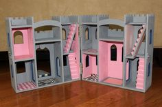 Wooden Castle (Peg People)- she got the unpainted wood castle at a craft store...
