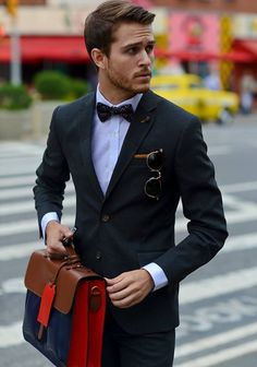 #casual #menswear #mensfashion #dapper #style #fashion #johnnyramirez #bowtie #blacksuit #fittedsuit #hair #leatherbag #mensbags