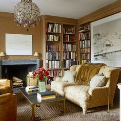 Camel-colored grasscloth wall covering in the Home Library of Aerin Lauder.