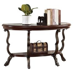 Glass-top demilune console table with an open bottom shelf and scrolling legs.  Product: Console tableConstruction M...