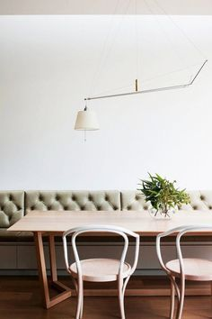 Fesselnd Muted Dining Space With A Green Bench, A Modern Wooden Table And A Low