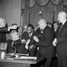 MLK and LBJ signing the Civil Rights Act of 1964