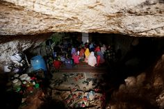 Internally displaced children attend a class inside a cave in the rebel-controlled village of Tramla, in Idlib province, Syria, on March 27, 2016.