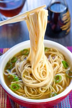 A bowl of quick and easy Chinese noodle soup with chopsticks holding some noodles above the bowl A delicious soup with plenty of vibrant flavors that's made all in one pot. Once you try this recipe, you'll never go back to the packaged soups again! Oriental Noodles, Asian Noodles, Spicy Thai Noodles, Sesame Noodles, Garlic Noodles, Japanese Noodles, Udon Noodles, Ramen Noodle Soup, Ramen Noodle Recipes