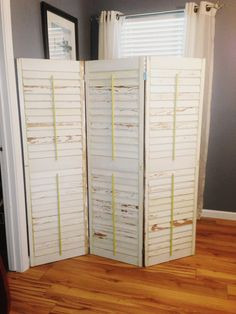 Room Divider made from 3 old shutters from the Green Project store in Nola. Simply sanded them and clear coated them so they wouldn't peel anymore then hinged them together. Perfect for hiding our treadmill in the corner.
