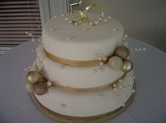 Golden 50th Wedding Anniversary Cake ... like this cake just touches of gold, not overkill