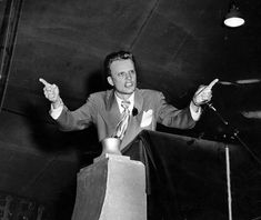 """1949: The Rev. Billy Graham speaks at his first crusade in Los Angeles. The young Southern Baptist preacher drew 350,000 people over eight weeks to a huge tent. Graham quoted Scripture  """"All across Europe, people know that time is running out,"""" he said. """"Now that Russia has the atomic bomb, the world is in an armament race driving us to destruction.""""  The event catapulted him to religious stardom."""