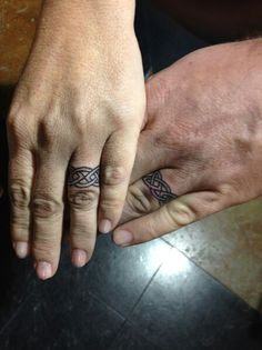 Mine and hubbys wedding ring tats. Diamonds are forever so are tattoos.