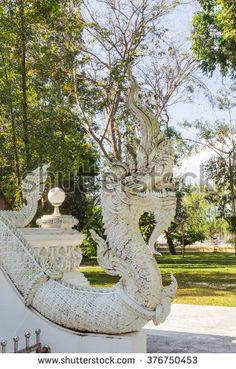 Thai Art, Single white Naka (giant snake) head statue at Thai Buddhist church with deep  depth of field, Tha Sak temple, Phuket province, South of Thailand - stock photo