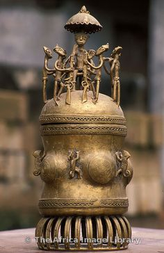 """Brass urn. The lost-wax technique is an old Ashanti craft, Kumasi, Ghana. These fine bronze vessels are also known as """"kuduo"""" and were used in funerals or to hold valuable or important items. Some kuduo were buried with the owner, and some of them were also placed in shrine rooms."""