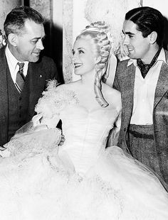 "Norma Shearer and Tyrone Power with director Woody Van Dyke on set of ""Marie Antoinette"""