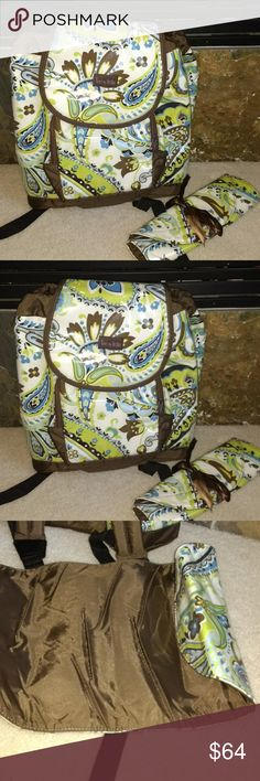 Timi & Leslie Designer Diaper Bag Timi & Leslie Designer Diaper Bag. Never Used, brand new without tags. Plastic covered diaper bagpack with one changing pad as shown in the picture.  Has lots of pockets. Zip up front big pocket and a zipper on side for easy access. Inner zip pocket plus three comparments to put diapers, bottles and other items.  Pull out string to close the diaper bag. Easy wipe off to clean any spills.  No tears or rips.  Price is negotiable, please make reasonable offers…