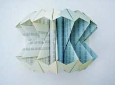 Folded Book Art Sculpture    One of a kind book sculpture ready to be shipped!    Book Titled:  Growth Factors  Compound Interest Tables   copyrighted 1967    Dimensions (on Canvas):    16 W x 11 H x 9 D    The unique book, featuring two different colors of white and baby blue, is a great addition to any room or studio.    The cover has been carefully taken off and binding is intact to holds its form.  The pages have been carefully folded and glued within themselves to create a unique…