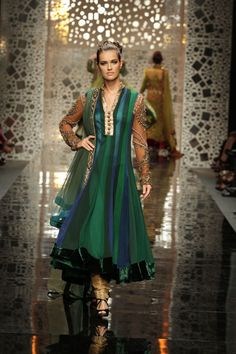 Obv. I am not a fashionista by any means, but I love the colors and length of this dress as well as the cool sleeves and front embellishment(Manish Malhotra Lakme Fashion Week 2011)